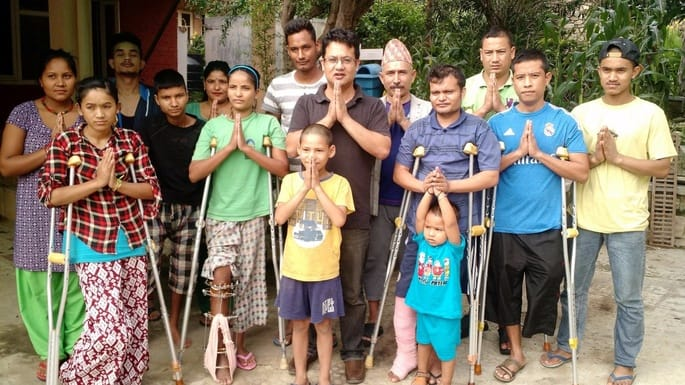 Samrat and patients at NHEDF saying 'Namaste'