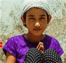 Nepalese girl saying Namaste